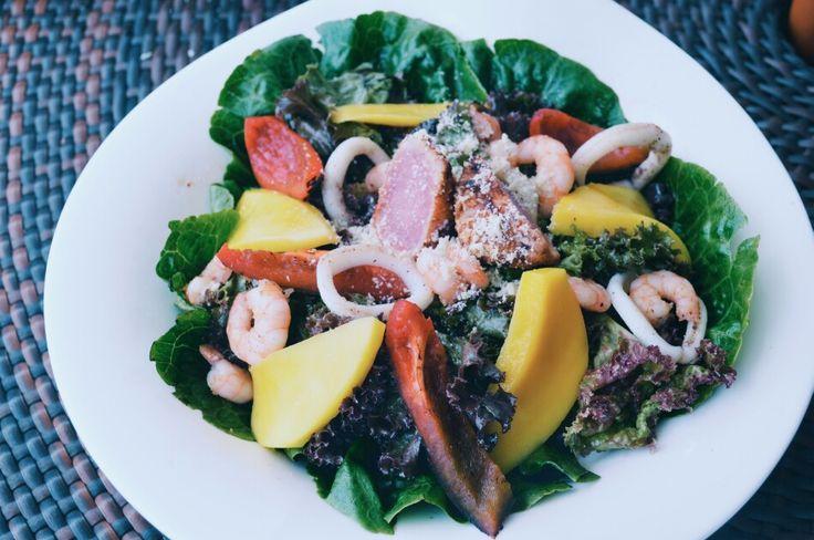 Mixed seafood lettuce salata and caesar salad w/ condiments