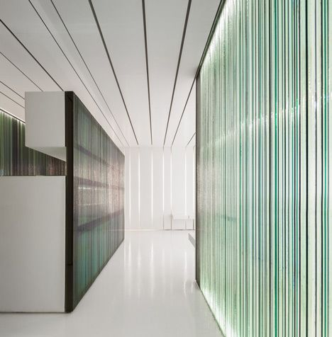 Dental Clinic - Stripy glass screens obscure views between rooms at this dental clinic in Torres Vedras, Portugal.