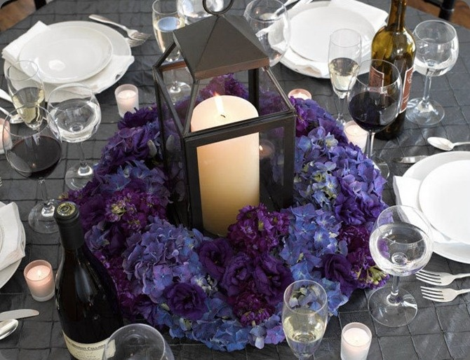 Purple And Blue Hydrangeas Surround Pillar Candles In A