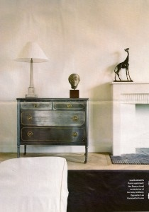 Salon in Lee Radziwill\'s Paris aparment - the Greek statue reminds her of her son Anthony - the giraffe is Peter Beard