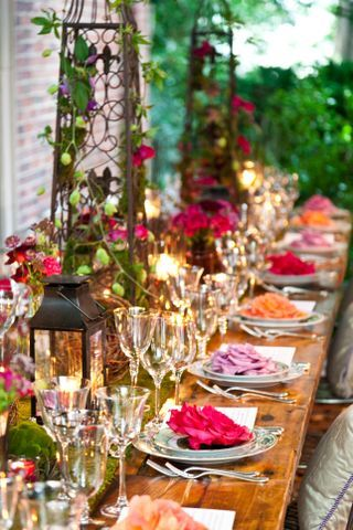 Garden themed tablescape - Love the flowers on the plates and the trellis centerpieces!