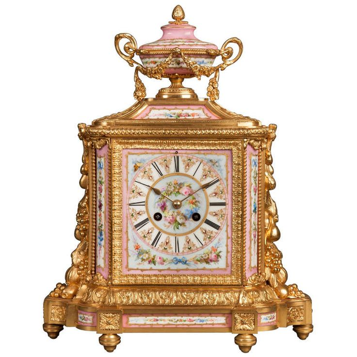 Mantle clock in the Louis XVI style constructed in ormolu and decorated with 'jewelled' Sevres style hand painted porcelain with rose ground, France c. 1870