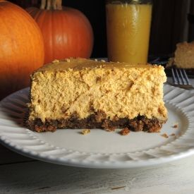 Pumpkin Cheesecake with a Pecan Gingersnap Crust and Chocolate Sauce
