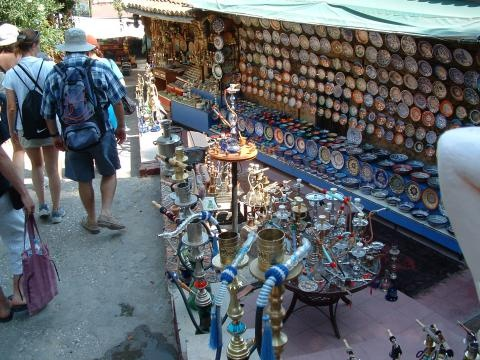 A shop in Antalya, with hookahs and decorated plates.  Hookah (hukkā or huqqah) is also known as a waterpipe narghile in Turkish. It is a single or multi-stemmed instrument for smoking flavored tobacco in which the smoke is passed through a water basin (often glass based) before inhalation.