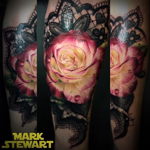 Tattoo by Mark Stewart of Four Aces Tattoo in Aldinga Beach, South Australia. Rose portrait with freehand lace background done on the arm. Thanks for looking :)