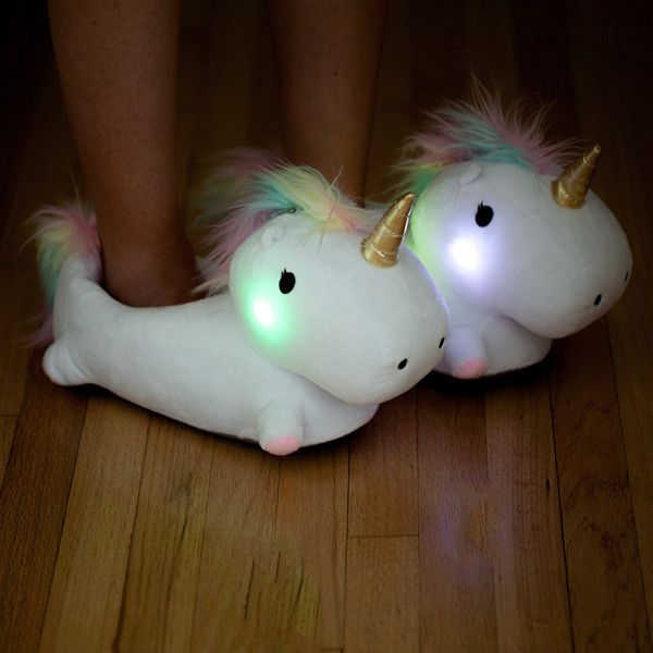 "Unicorn Light Up Slippers | $39.99 | Light up your life, or at least your route to the bathroom, with our new and very cute Light Up Unicorn Slippers! Be the envy of all your friends as you parade these cozy unicorns around your next slumber party. Guaranteed to literally brighten up any outfit, the Unicorn Slippers ensure that every step you take is a magical one! One Size fits most, up to Women's size 12. 6-color changing LED bulb. Ea slipper: 13x9x6"". 4xCR2023 Batteries included."