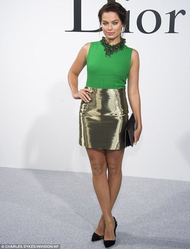 All that glitters: Margot Robbie showed off her slim legs in a high waisted gold skirt in New York on Wednesday