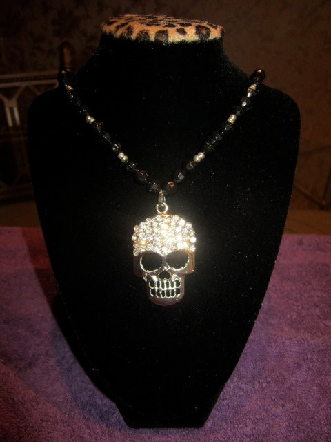 got a variation of this for my bday lovee it - Serious Skull Necklace-$40.00-buy it at Rack Bling on Etsy.com    This is one of my top sellers-it can be made in any color beads-Order yours now-