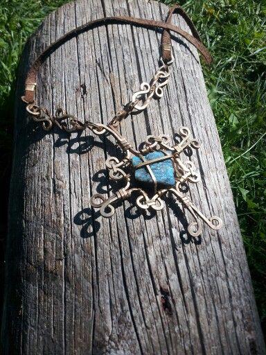 Cross of vintage brass and labradorite