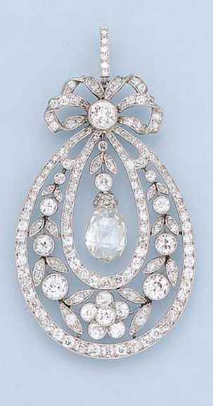 A BELLE EPOQUE DIAMOND PENDANT/NECKLACE  Designed as a graduated floral wreath within diamond line borders suspending a central briolette-cut diamond to the bow surmount and fine link neckchain, millegrain setting, circa 1910.