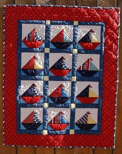 Sailboat Baby Quilt Pattern - Could use any design for the appliqued sailboats.  Also might stagger design blocks with solid color blocks