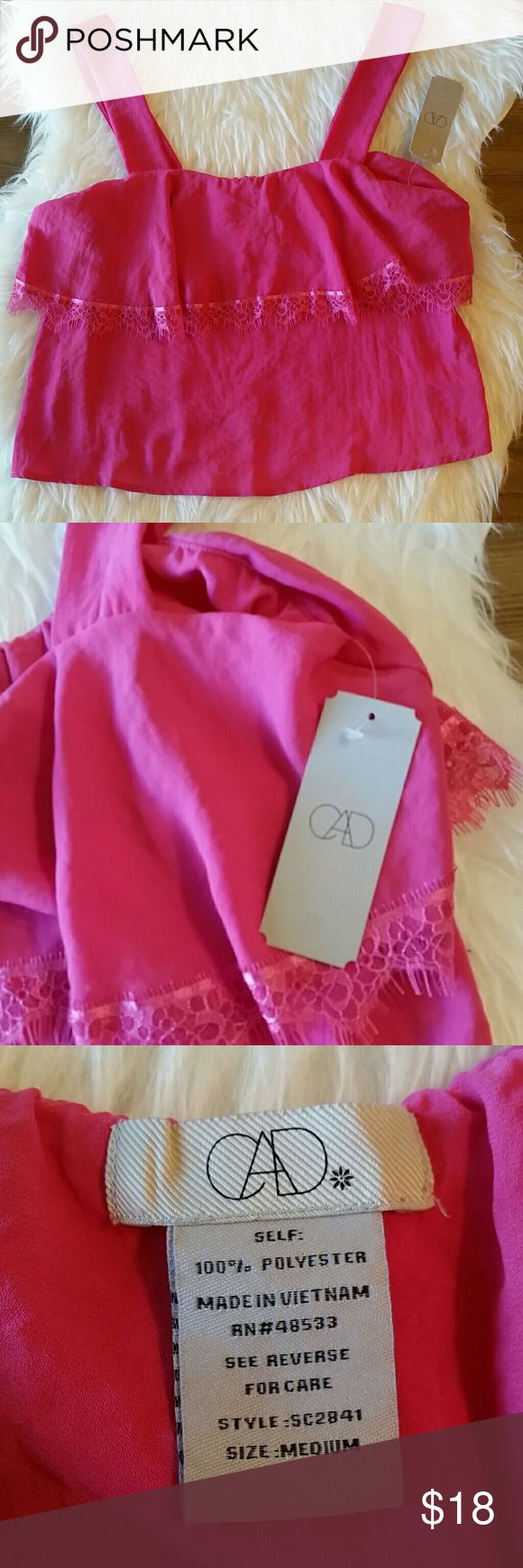 CAD Lace Detail Tank in Pink NWT NEW with Tags! Super cute pink tank! Perfect for Valentine's Day! Wear it under a cardigan or jacket with jeans and boots! Foldover fabric with lace detail. Wide straps.  Size medium Laying flat measures approximately  Bust 16 inches- has elastic so will stretch  Length 20 inches  Open to reasonable offers. Bundle and save! CAD Tops Tank Tops