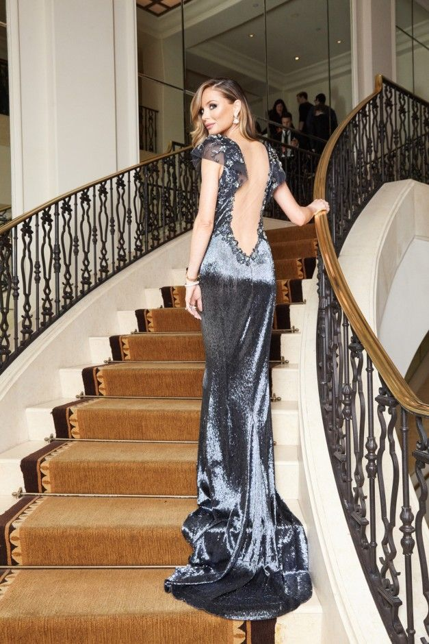 Georgina Chapman Gets Ready for Weinstein Company's Pre-Oscar Bash:As co-founder of Marchesa, pretty much any party-ready poufy dress is as good as hers; and when you factor in her plus-one to these things (Weinstein Company co-chair and producer Harvey Weinstein), chances are you're more or less set for a picture-perfect Oscars weekend. ---- Silver metallic dress with back cut out. | Coveteur.com