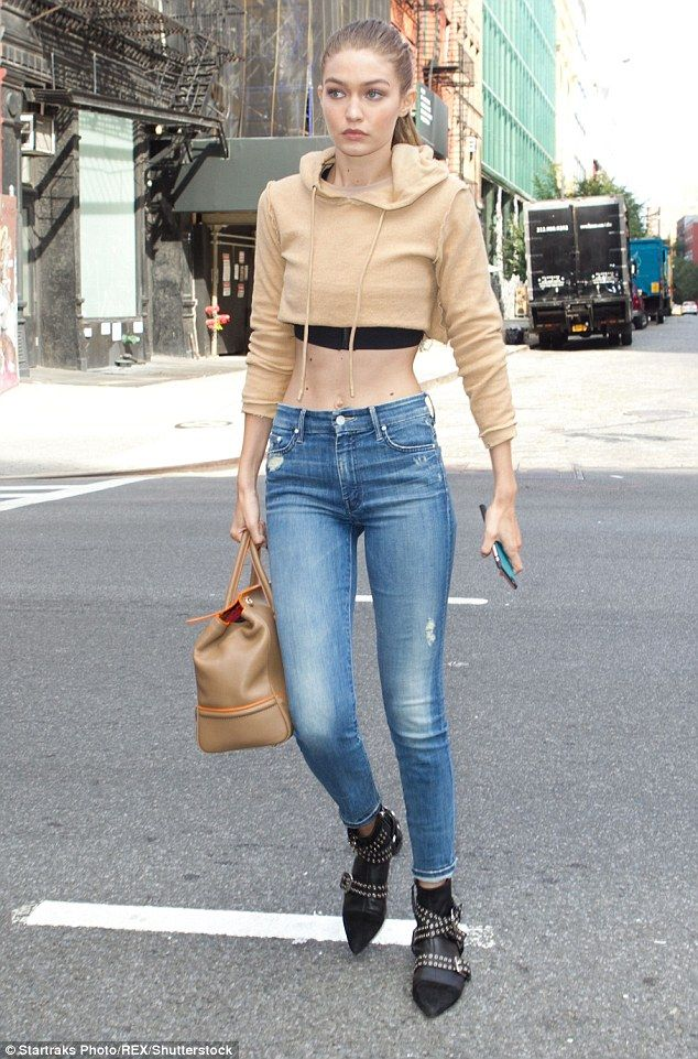 Supermodel: The 21-year-old flashed her midriff in a nude hoodie and jeans while out in New York