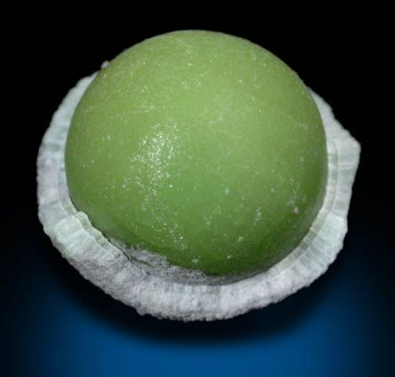 Wavellite in green spherical formation with silky surface luster. The formation has a 1 mm layer of gray wavellite crystals that grew over the central nodule. Found on Maudlin Mountain, Arkansas