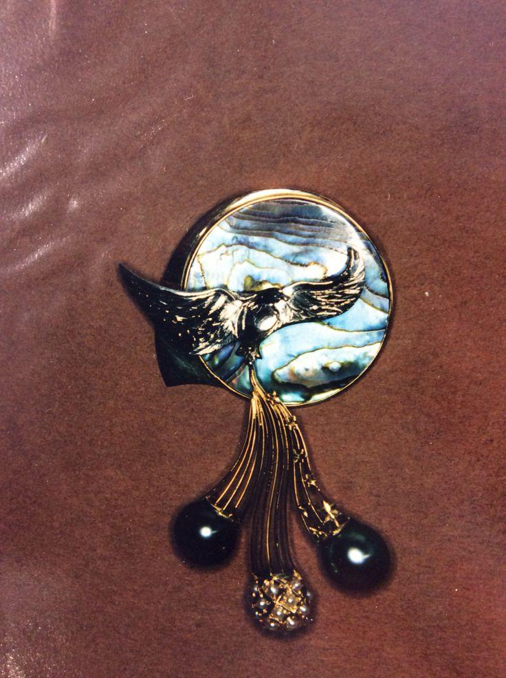 commemorative pendant featuring Paua shell a sculptured eagle  and tahitian pearl drops