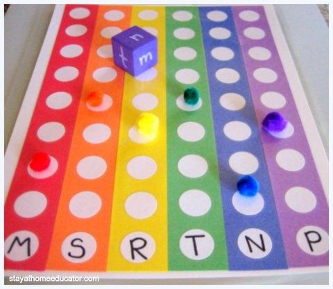 Rainbow Letter Identification Game- love it could be adapted for so many things- numbers, sight words, word families, rhyming words. . .
