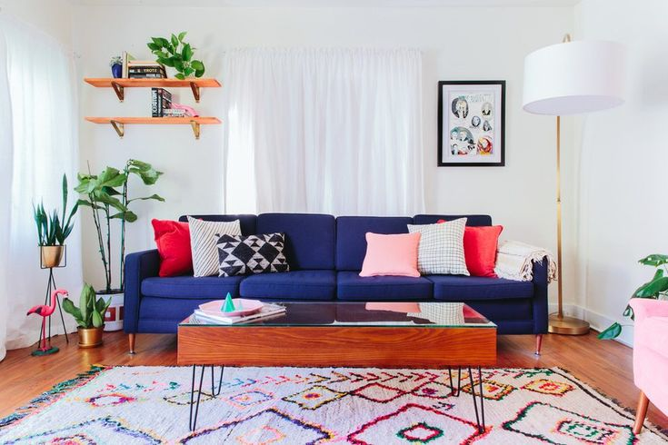 los angeles john derian sofa with contemporary decorative pillows living room eclectic and colorful indoor plants