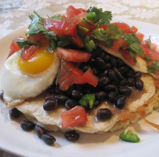 Dr. Phil 20/20 Diet Recipes - Black Bean Huevos Rancheros is a spicy tasty dish with tortillas, cheese, eggs, onion, lime juice, tomato, pepper, black beans and green onion.