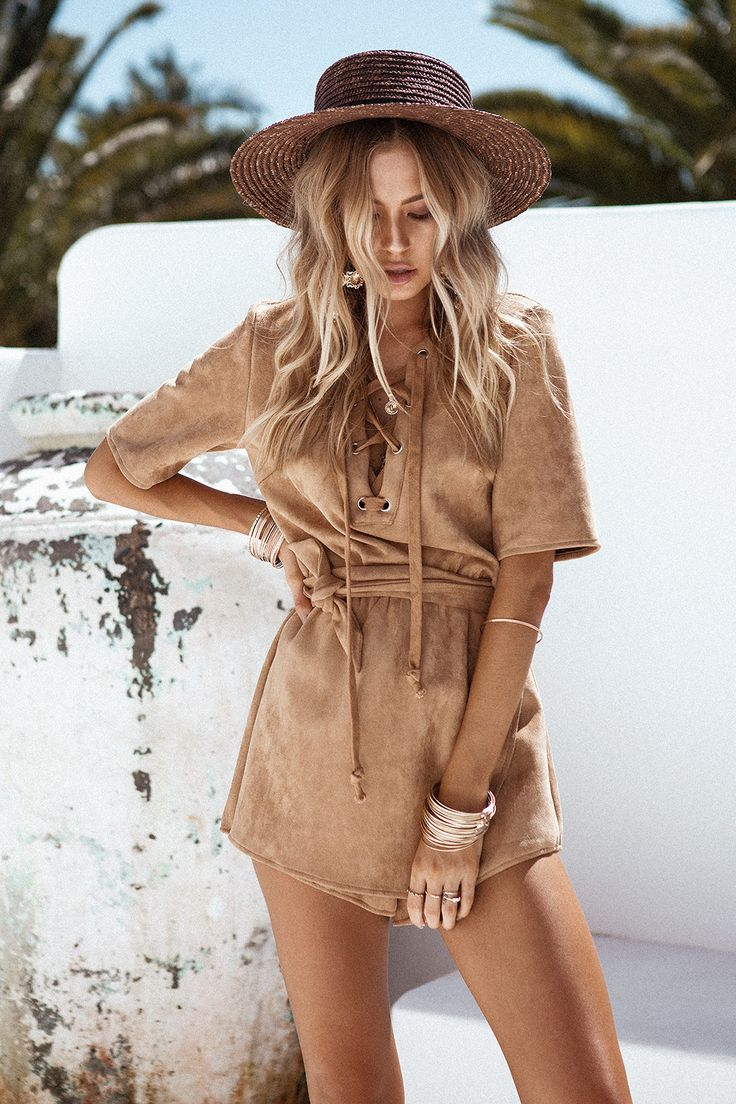 Obsessed with the structure and details of the Monte Carlo Playsuit, made from a faux suede fabric in a tan hue. It features a V neckline with lace up detailing, short sleeves, an asymmetric overlay across thighs, elasticated waistband and matching waist tie included. Complete the look with black slides and gold accessories. By Sabo Skirt.