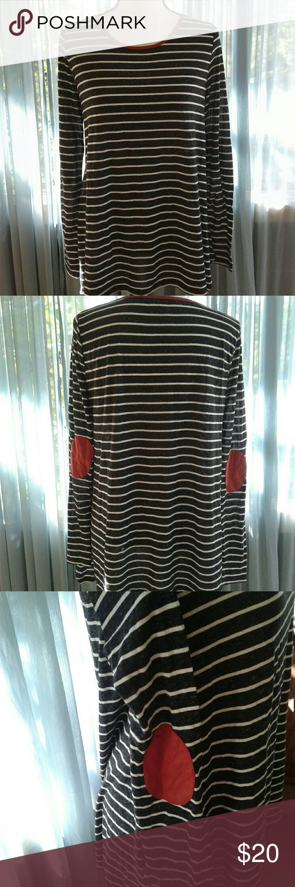 """NWT Umgee top Women's brand new with tags Umgee black and white stripe long sleeve asymmetrical top with copper elbow patches and trim around neckline. Size Medium. Measurements SS 16"""" Chest 20"""" length 25"""" sleeve 26"""". Thanks for looking! Bundle to save! Umgee Tops Tees - Long Sleeve"""