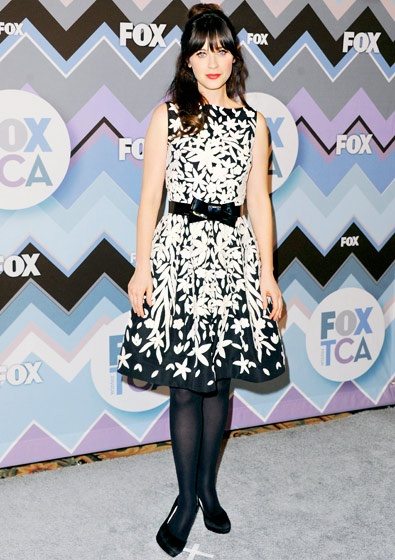 Zooey Deschanel works a wardrobe that is totally '50s in a black and white Naeem Kahn dress at a January 2013 Television Critics Association