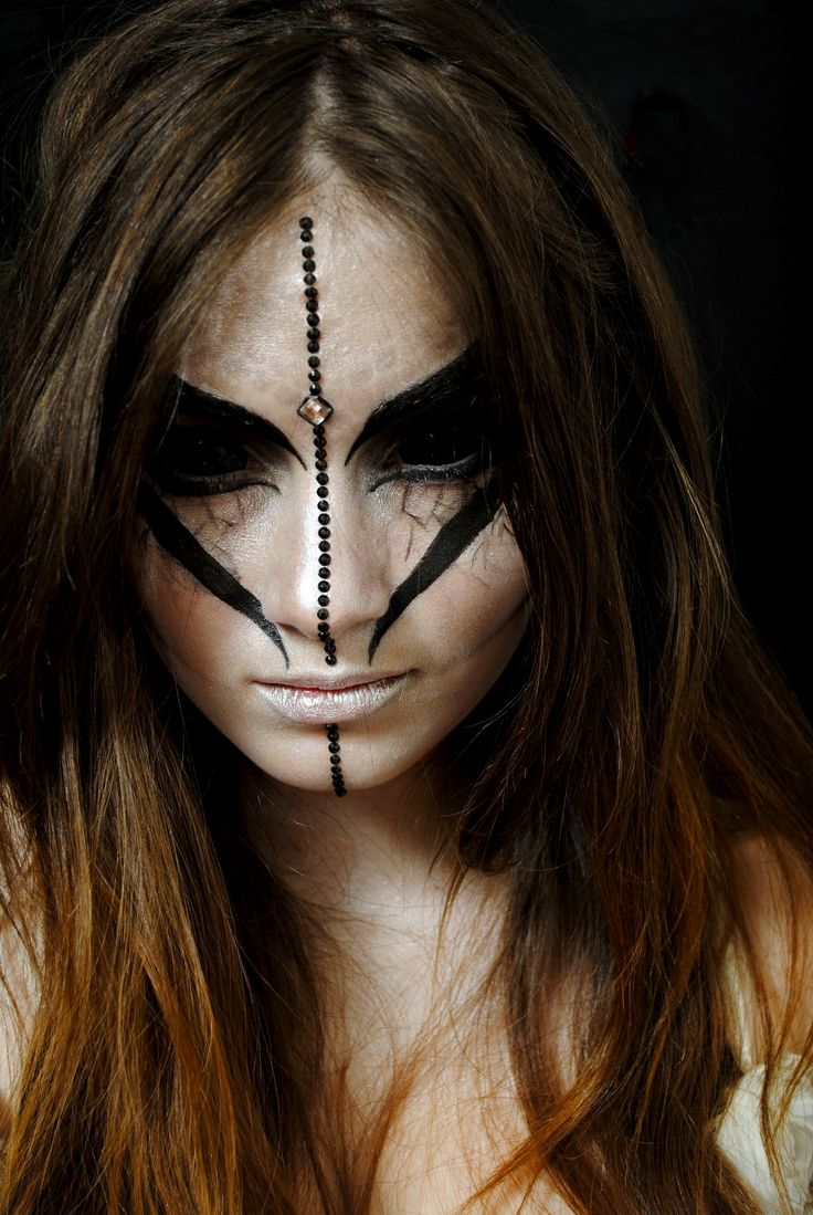 Love the black contacts for this alien creative makeup look!