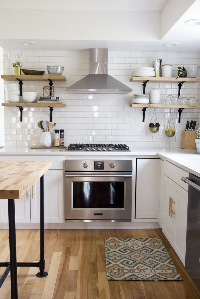 i like the contrast between the wood and the white and the brass handles are nice white tile backsplashwhite subway tileskitchen - White Kitchen With Subway Tile Backsplas