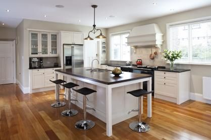 A warm timber top was specified for the island to echo the concept of a central table around which everyone gathers. The renovated kitchen features a double Hideaway Bin. Click the image for the full article.