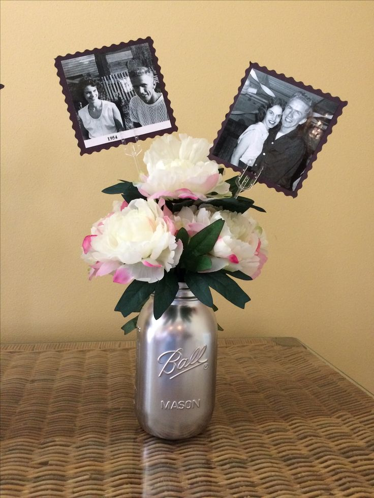 60th wedding anniversary mason jars with photos, could also be used as wedding or rehearsal dinner table centerpiece. I sprayed the jars with Krylon Brilliant Aluminum finish, added artificial peonies and photos secured on floral picks.