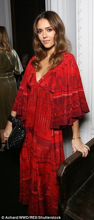 Lady in red: Showing off a glimpse of cleavage with the deep V-Neck, she teamed it with a ...