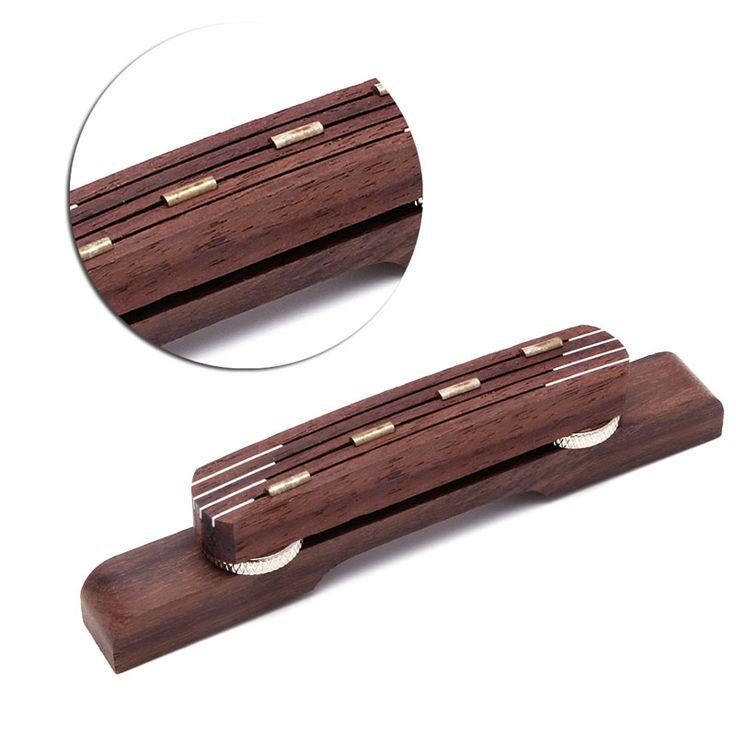 $4.93 (Buy here: https://alitems.com/g/1e8d114494ebda23ff8b16525dc3e8/?i=5&ulp=https%3A%2F%2Fwww.aliexpress.com%2Fitem%2F1PC-Guitar-Parts-Durable-Rosewood-Guitar-Bridge-Mandolin-Bridge-For-Hofner-Bass-Guitar-Adjustable%2F32751590899.html ) 1PC Guitar Parts Durable Rosewood Guitar Bridge Mandolin Bridge For Hofner Bass Guitar Adjustable for just $4.93