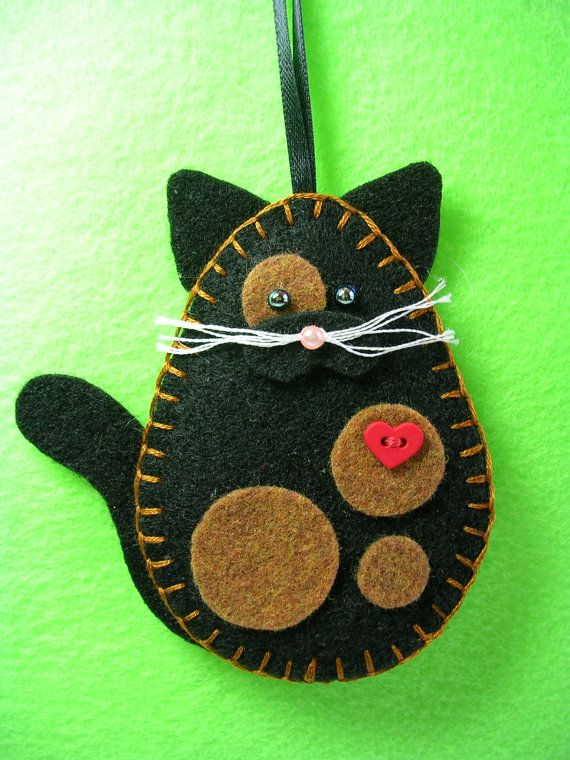 This charming kitty cat measures approx. 4 high x 3 1/2 wide. It is hand cut and sewn and lightly padded with fiberfill. The cats listed are my own design and cannot be an exact replica of every kind and color of cat. I have therefore taken an artistic abstract interpretation of some of the more well known type of cats. The heart button represents the kitty cats love for its guardian. For the torti cat whose main colors are black and red, I have used circles (for a touch of whimsy) to i...
