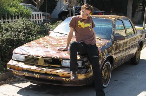 He gots that swag, baby...check out his custom 1989 Oldsmobile Cutlass Ciara--with Louis Vuitton paint job.  If this was a blind date and I saw this car, I would not even open the door.  I would hide.  Permanently.