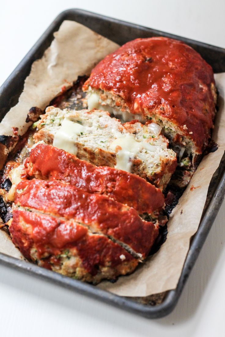 HEALTHY LOW CARB Turkey Zucchini Meatloaf stuffed with pepper jack and topped with the most delicious sauce EVER!