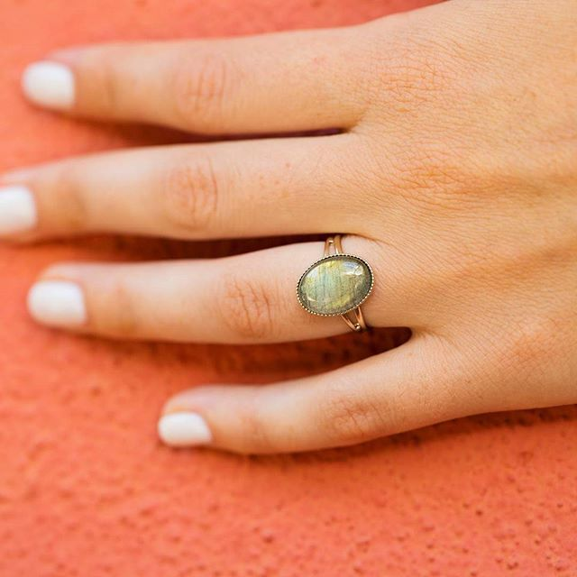 "🎉🎉🎉 J-2 !! 🎉🎉🎉  En attendant on révise ses classiques avec la belle bague ""Stone"" en Labradorite, la pierre aux multiples propriétés bienfaisantes ❤    @valentinemichelphotography  #bijoux #jewels #surprise #new #collection #comingsoon #friday #bague #labradorite #Perfect #color #lilygarden #french #paris #madeinfrance #gold #accessories #lifestyle #instagood #instajewels #photooftheday #ootd #follow #wednesday"