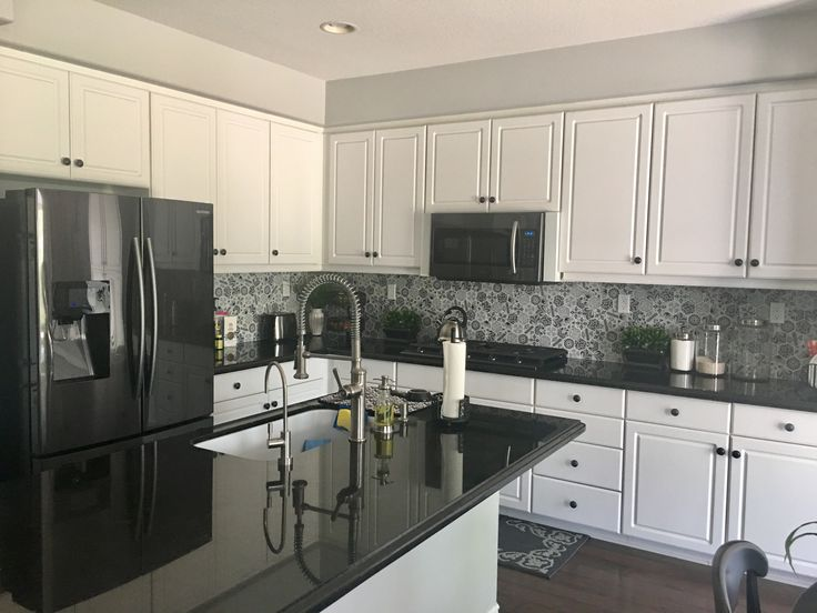 Nice White Cabinets; Black Granite Countertops; Black And White With Grey  Backsplash; Black SS