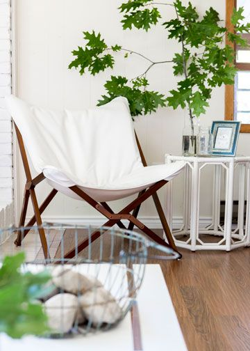 The white Draper lounge chair and the white Regeant side table from www.mirens.com