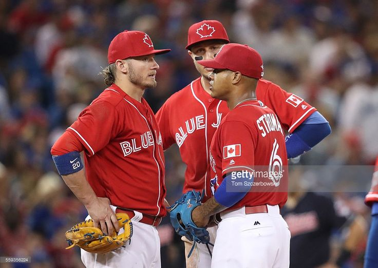 Marcus Stroman #6 of the Toronto Blue Jays is met on the mound by Josh Donaldson #20 and Troy Tulowitzki #2 shortly before being relieved in the seventh inning during MLB game action against the Cleveland Indians on July 1, 2016 at Rogers Centre in Toronto, Ontario, Canada.