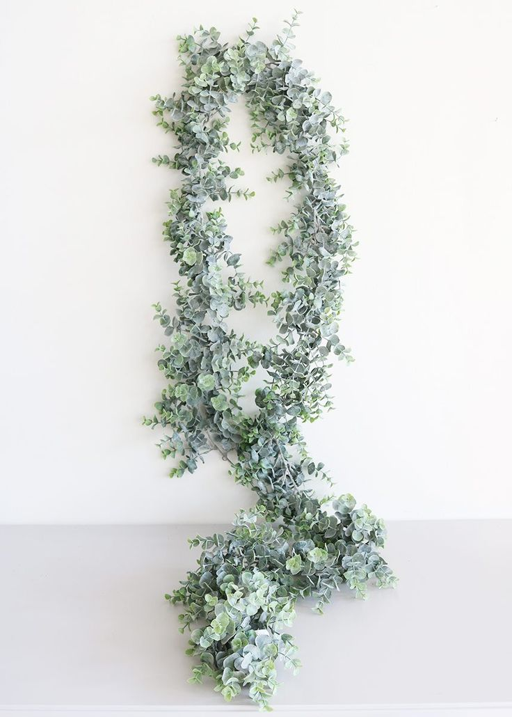 Faux eucalyptus garlands at Afloral.com make affordable event decorating easy. For wedding or home, artificial garlands are not just for hanging but are the new trend for centerpieces.
