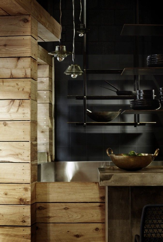 Another very dark kitchen, but more modern and urban - I like the used of wood slats, subway-esque tiles, stainless steel and cast iron