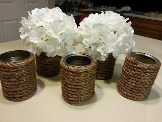 Flower cans. All you need is a soup can, rope, and hot glue. Would work as candle holders too