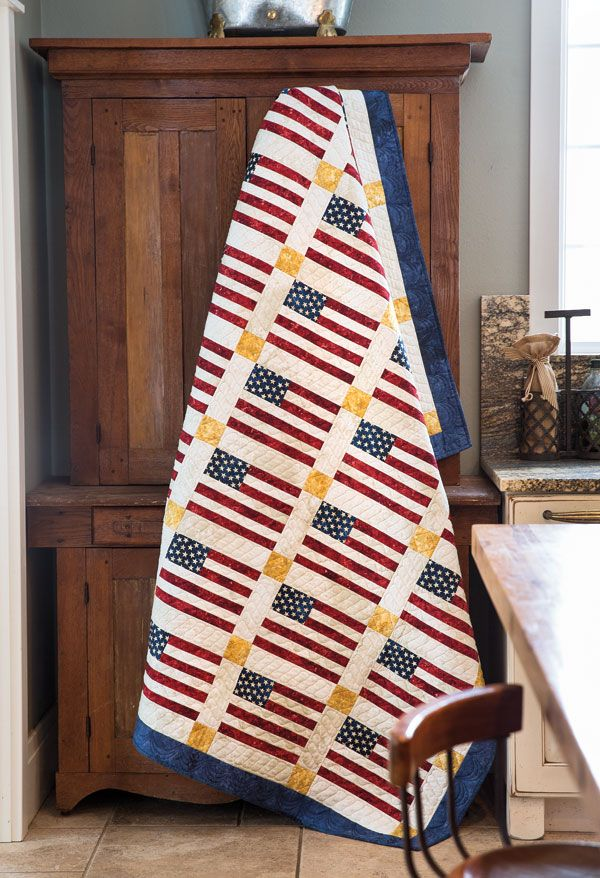 This Quilt of Valor by Marianne Fons is a good example of a simple design that makes great impact. Strip piecing makes the flags on this patriotic quilt quick to piece.