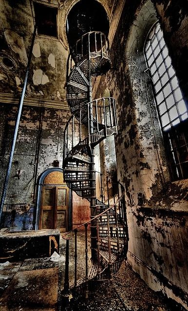 """An urban explorer never knows what awaits during infiltration of a crumbling building. This Victorian spiral staircase was captured at Maltings """"S"""", an abandoned brewery in Lincolnshire, England. The photograph is titled Elegance Unravelling by  DigiTaL~NomAd."""