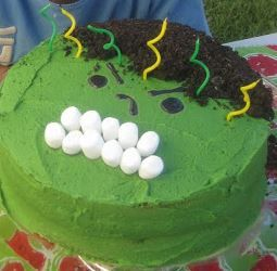 Incredible Hulk cake for 6th birthday. Used two round cakes, frsoted green. Hair is made of crushed oreos, eyes made of gel icing, and mouth made of marshmallows.