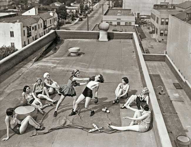 Women boxing on a roof in the 1930s.