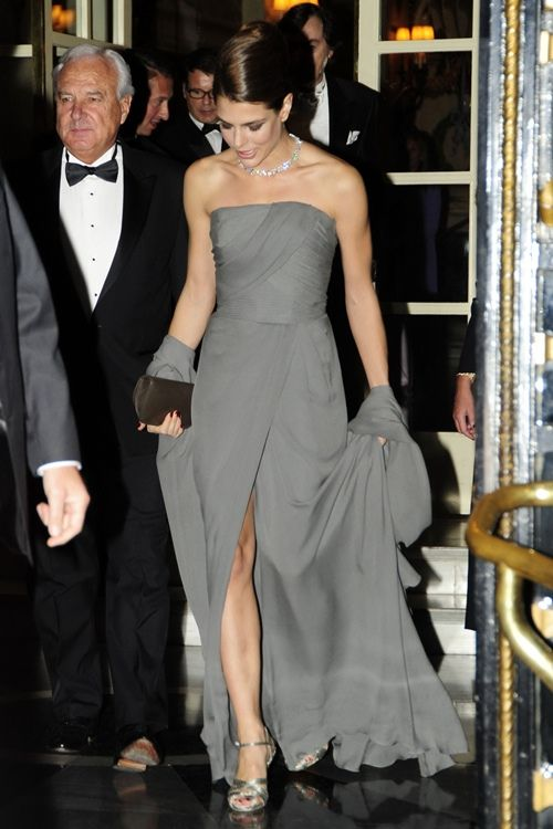 Charlotte Casiraghi in a floor-length grey strapless gown accessorising with silver heels, a Gucci clutch bag and striking diamond necklace