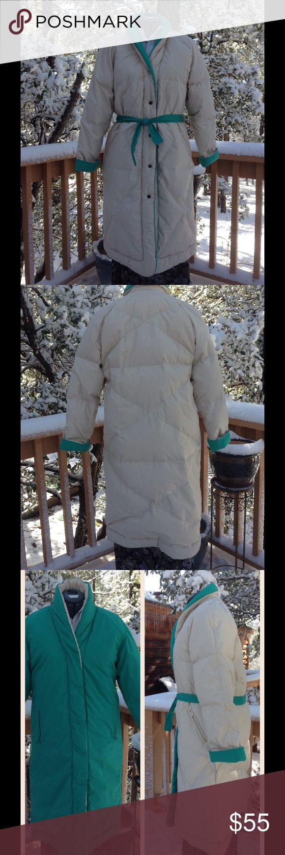 Saxton Hall Coat This coat is poly/cotton, with a fill of 80% down, and 20% waterfowl feathers. Totally reversible, off white on one side, green on the other. Two coats in one! There is a green fabric belt, so it can be worn with or without. It has shawl type roll collar, and zip pockets on each side. The only flaws are a smudge on the off white side at the top of the collar, faint pen mark on left sleeve, and a black smudge on green side of right cuff. I do not have a washing machine big…