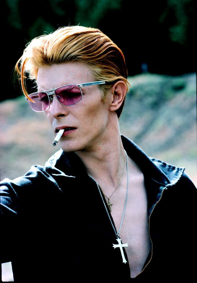 """David with cigarette on a break from filming The Man Who Fell to Earth in New Mexico, 1975. This became a Rolling Stone cover and a popular image."""