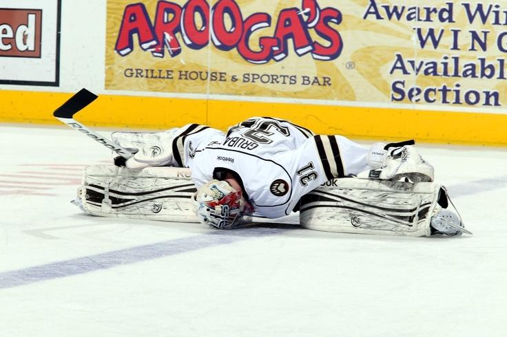 04.21.13 - Hershey Bears goaltender Philip Grubauer stretching during warmups. Photo courtesy of JustSports Photography